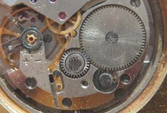Clockwork. Gears, springs and other parts of the watch are visible. royalty free stock photo