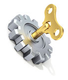 Clockwork key in the gear Stock Photo