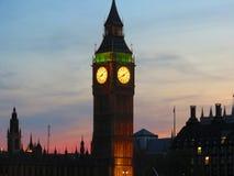 A clockwork lit up orange Royalty Free Stock Photos
