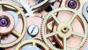 Clockwork. Macro detail vintage spinning gears in old clockwork stock footage
