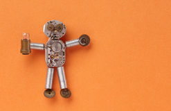 Clockwork mechanical character made of cogs wheels gears and hand watch elements. Funny abstract toy with light lamp Royalty Free Stock Photography