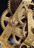 Clockwork mechanism. Detail of clock mechanism showing interlocking gears and tensioned spring stock photo