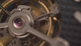 Clockwork mechanism with jewels. Mechanism of a watch with jewels. Open clockwork and fragments of shiny gears. Close up 4k macro shot. Time and work concept stock video footage