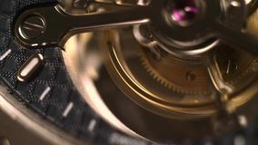 Clockwork Mechanism with Jewels. Mechanism of a watch with jewels. Open clockwork and fragments of shiny gears. Close up 4k macro shot. Time and work concept stock video