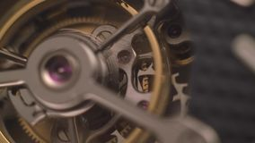 Clockwork Mechanism with Jewels. Mechanism of a watch with jewels. Open clockwork and fragments of shiny gears. Close up 4k macro shot. Time and work concept stock footage