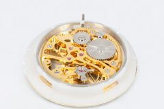 Clockwork mechanism of a pocket watch in gold, with jewels, close-up. A close-up of a clockwork mechanism of a pocket watch in gold, with jewels Royalty Free Stock Photography