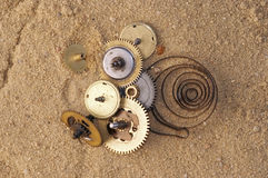 Clockwork mechanism on the sand Stock Photos