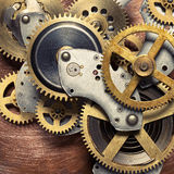 Clockwork. Metal collage of clockwork gears on copper background Royalty Free Stock Photography