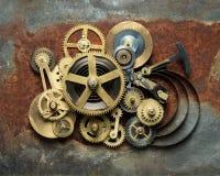 Clockwork. Metal collage of clockwork on rusty background stock photos