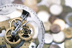Clockwork with money Stock Image