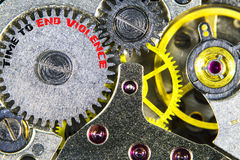 Clockwork old mechanical  high resolution with words Time to End. The clockwork old mechanical  high resolution with words Time to End Violence Royalty Free Stock Images