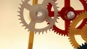 Clockwork spin. Working multicolor plastic toy cog of clockwork on gradient dark screen stock video