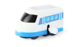 Clockwork toy white train with blue windows Stock Image