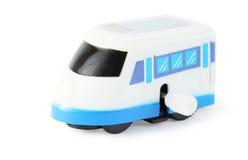 Clockwork toy white train with blue windows. Bright clockwork toy white train with blue windows on white background Stock Image