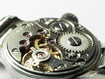 Clockwork under repair. Inside mechanism clockwork, open back cover Stock Image