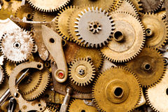 Clockwork vintage parts and steampunk cogs gears background. Aged mechanical clock wheels close-up. Shallow depth of
