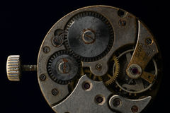 Clockworks. Clock mechanism against black background Royalty Free Stock Photo