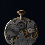 Clockworks. Clock mechanism against black background Royalty Free Stock Photos