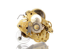 Clockworks mechanism of old vintage watch on white background wi Royalty Free Stock Image