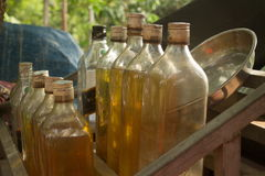 Cloder medium close up of gasoline bottles on a wooden rack in rural Cambodia Royalty Free Stock Photo