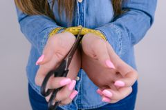 Clodeup cropped photo of crying exhausted she her lady holding black scissors in hands giving you asking to help isolated grey. Background royalty free stock photography