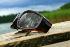 Clodus & Glasses. Clouds reflection on sunglasses Royalty Free Stock Images