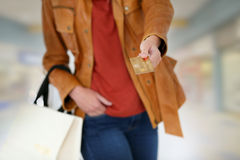Cloes-up of credit card of shopping woman Royalty Free Stock Photo