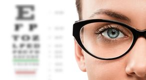 Close up of young woman wearing eyeglasses royalty free stock images