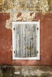 Cloesed woodn window with white border Stock Photo