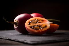 Tamarillo on stone board. Cloesup of tamarillo fruits on stone board Royalty Free Stock Image