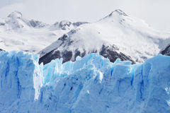 Cloeup of Glacier with Mountains in Background Stock Photo