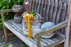 Clog as decoration on a wooden bench Stock Images