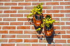 Clog shoes on a brick wall, the Netherlands Royalty Free Stock Photo