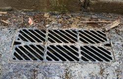 Clogged storm drain. metal bars stock image