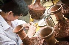 Cloisonné artisan Stock Images