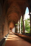 The cloister. A long cloister in a catholic cathedral with a series of columns Stock Photos