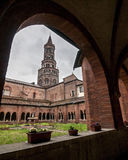 Cloister and bell tower of the abbey of Chiaravalle Stock Images