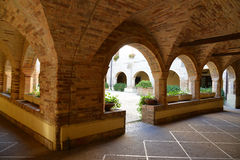 Cloister with brick arches Stock Image