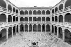 Cloister and colonnades of the University of Valladolid. Wide-angle view of the four sided cloister and inner colonnades of the Colegio de Santa Cruz, the first Royalty Free Stock Photo