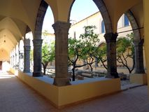 Cloister of the convent of St. Francis in Fondi, Italy. Fondi, Italy - 10 june 2013: Cloister of the convent of St. Francis. Fondi`s urban core is located in Royalty Free Stock Image