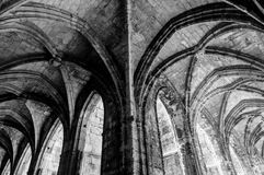 Cloister corridor arcs look like a mirror at Saint Just Cathedral at Narbonne in France royalty free stock photography
