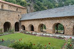 Cloister garden of the Romanesque Abbey of Saint Martin du Canig Royalty Free Stock Photography