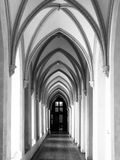 Cloister with gothic rib vault ceiling. Medieval castle cloister with gothic rib vault ceiling. Black and white image Stock Photo