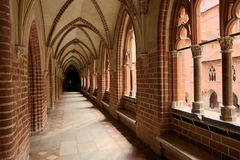 Cloister in the medieval Castle of the Teutonic Order in Malbork, Poland. Stock Photos