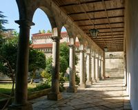 Cloister of romanesque monastery of Paco de Sousa stock photos