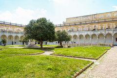 The cloister of San Martino chartreuse in Naples. AT NAPLES - ON 04/20/2017 - The cloister of San Martino chartreuse in Naples with its skulls decoration Royalty Free Stock Image