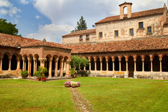 Cloister of San Zeno Cathedral in Verona showing ornate arches and carvings. In summer royalty free stock image