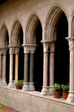 Cloisters. With potted plants and garden Royalty Free Stock Images