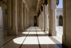 Cloisters, Grand Mosque, Oman. The cloisters of the Sultan Qaboos Grand Mosque in Oman stock photo