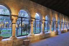 The Cloisters - NYC. Colonnade and garden at The Cloisters, the branch of The Metropolitan Museum of Art devoted to the art and architecture of medieval Europe Royalty Free Stock Photo